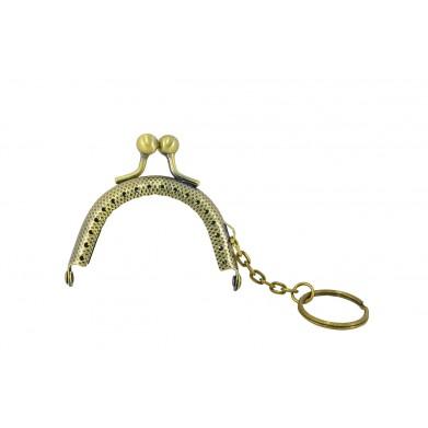 Boquilla monedero oro viejo 6 cm
